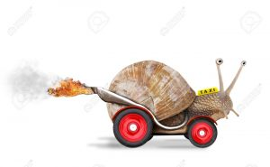 13551897-Speedy-snail-like-car-racer-Concept-of-speed-and-success-Wheels-are-blur-because-of-moving-Isolated--Stock-Photo
